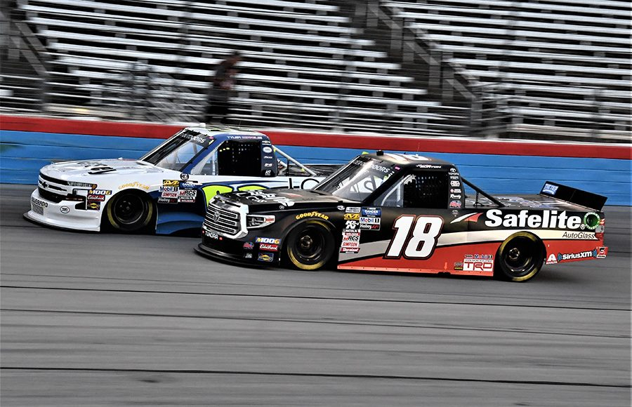 Harrison Burton (18) races alongside Tyler Dippel during Friday's NASCAR Gander Outdoors Truck Series race at Texas Motor Speedway. (Al Steinberg Photo)