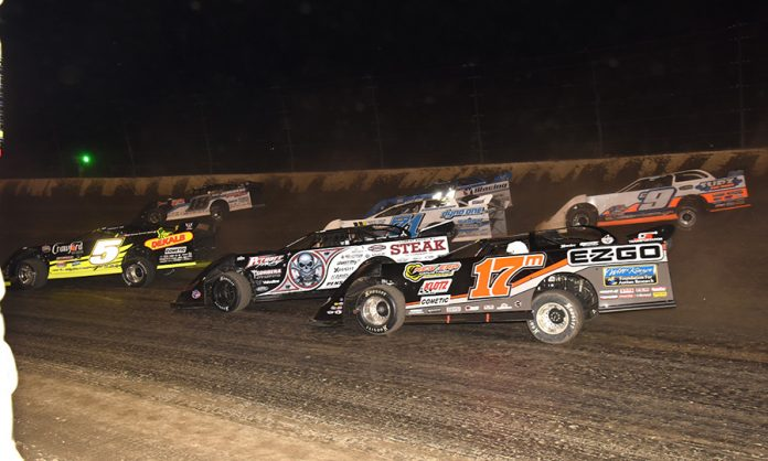 Drivers battle for position during Friday's Dirt Late Model Dream preliminary event at Eldora Speedway. (Paul Arch Photo)