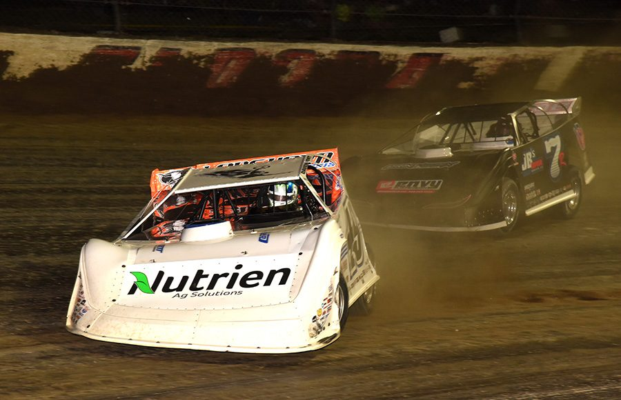 Jonathan Davenport (49) races ahead of Kent Robinson during Friday's Dirt Late Model Dream preliminary event at Eldora Speedway. (Paul Arch Photo)
