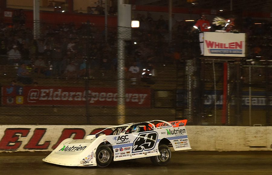 Jonathan Davenport crosses the finish line to win one of two Dirt Late Model Dream preliminary events Friday at Eldora Speedway. (Paul Arch Photo)
