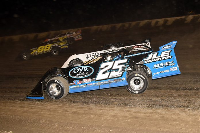 Mason Zeigler (25z) rides the low line while battling in the pack during Friday's Dirt Late Model Dream preliminary event at Eldora Speedway. (Paul Arch Photo)