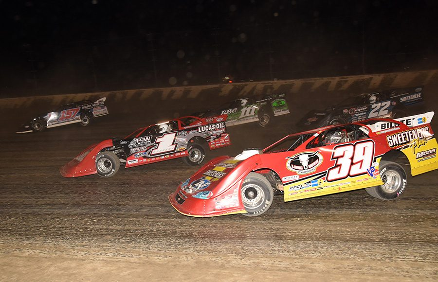 Tim McCreadie (39), Earl Pearson Jr. (1) and Gregg Satterlee (22) race amongst a group of cars during during Friday's Dirt Late Model Dream preliminary event at Eldora Speedway. (Paul Arch Photo)