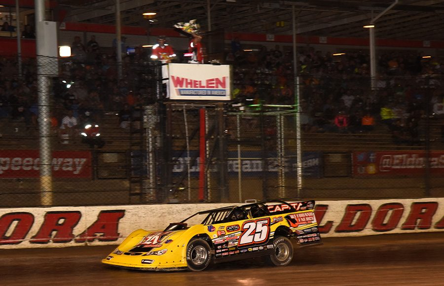 Shane Clanton takes the checkered flag to win the second preliminary Dirt Late Model Dream feature Friday at Eldora Speedway. (Paul Arch Photo)