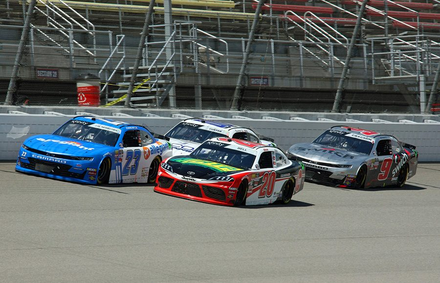 John Hunter Nemechek (23) and Christopher Bell (20) lead a pack of cars during Saturday's NASCAR Xfinity Series event at Michigan Int'l Speedway. (Todd Ridgeway Photo)