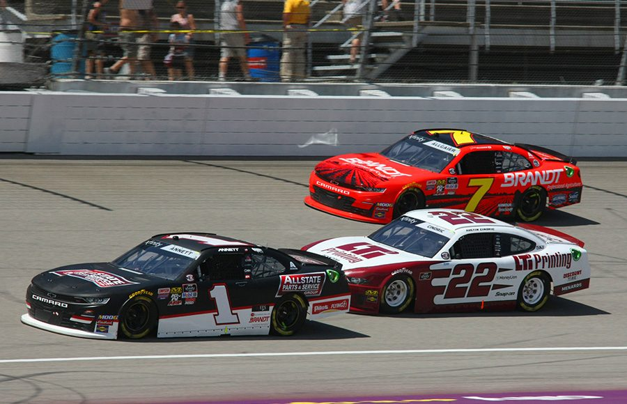 Michael Annett (1) leads Austin Cindric (22) and Justin Allgaier battle for position during Saturday's NASCAR Xfinity Series event at Michigan Int'l Speedway. (Todd Ridgeway Photo)