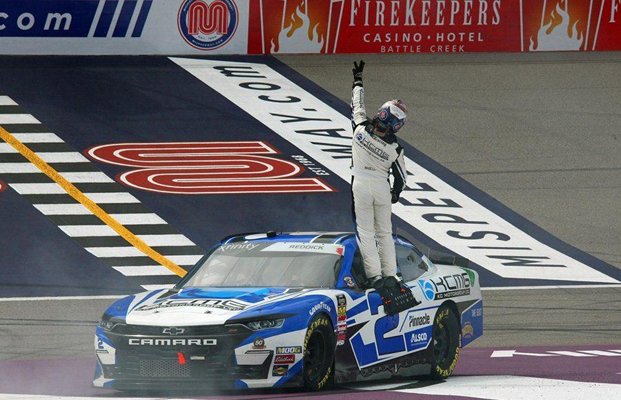 Tyler Reddick celebrates after winning Saturday's NASCAR Xfinity Series race at Michigan Int'l Speedway. (Todd Ridgeway Photo)