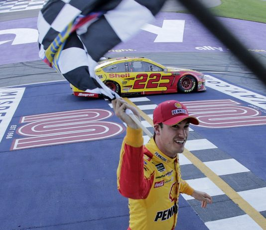 Joey Logano celebrates after winning the FireKeepers Casino 400. (HHP/Alan Marler Photo)