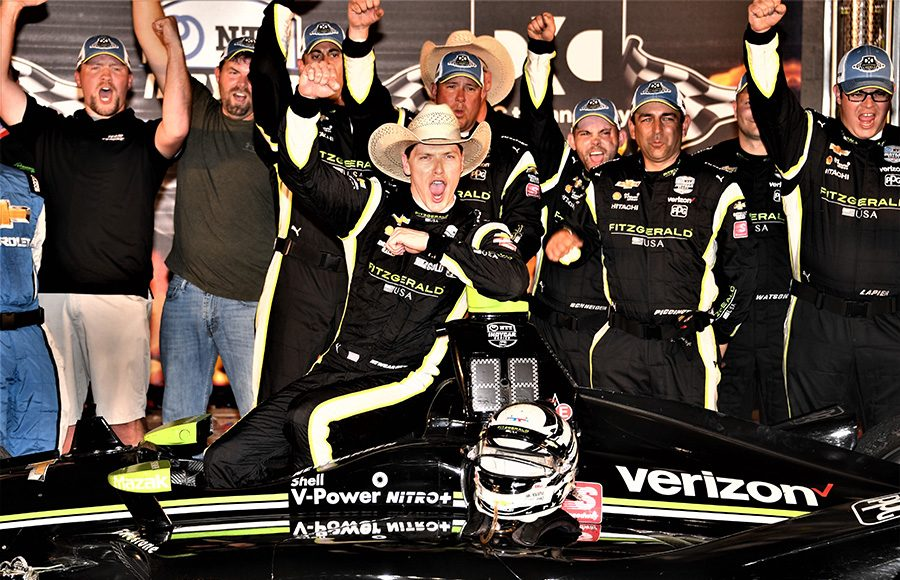 Josef Newgarden poses in victory lane after winning Saturday's DXC Technology 600 at Texas Motor Speedway. (Al Steinberg Photo)