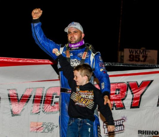 Kyle Bronson and his son in victory lane at Fayetteville Motor Speedway. (LOLMDS photo)