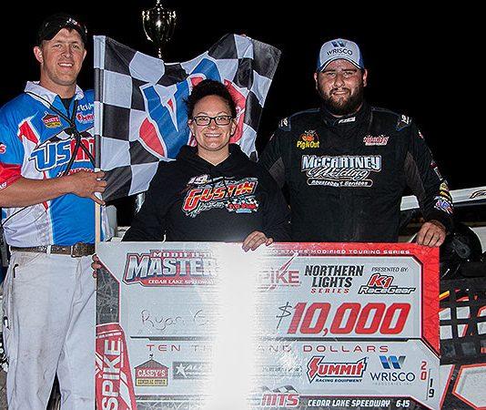 Ryan Gustin in victory lane at Cedar Lake Speedway. (USMTS photo)