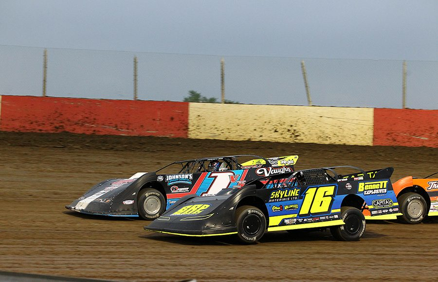 Tyler Bruening (16) races under Will Vaught during Saturday's Lucas Oil MLRA event at Dubuque Fairgrounds Speedway. (Mike Ruefer Photo)