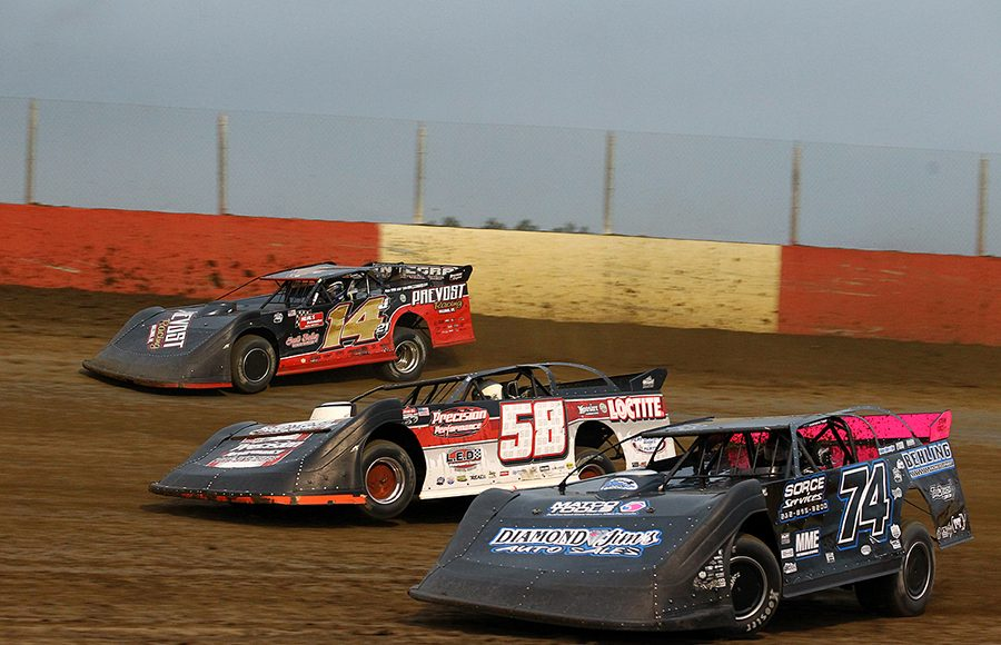 Mitch McGrath (74), Dave Eckrich (58) and Jake Neal race three-wide during Saturday's Lucas Oil MLRA event at Dubuque Fairgrounds Speedway. (Mike Ruefer Photo)