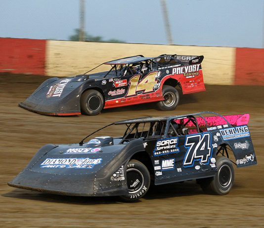 Mitch McGrath (74) battles Jake Neal during Saturday's Lucas Oil MLRA event at Dubuque Fairgrounds Speedway. (Mike Ruefer Photo)