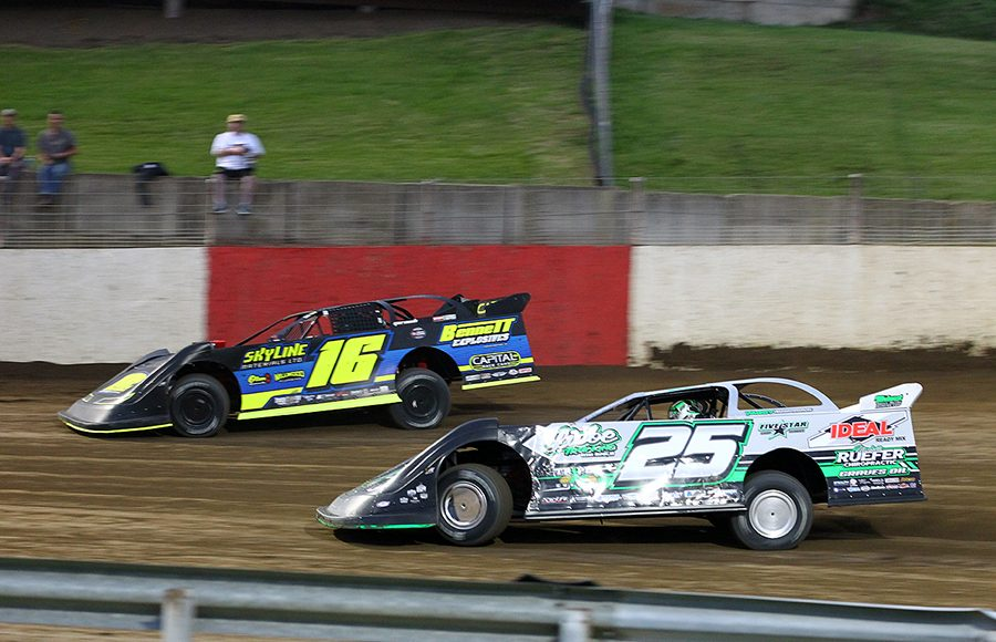 Chad Simpson (25) chases Tyler Bruening during Saturday's Lucas Oil MLRA event at Dubuque Fairgrounds Speedway. (Mike Ruefer Photo)