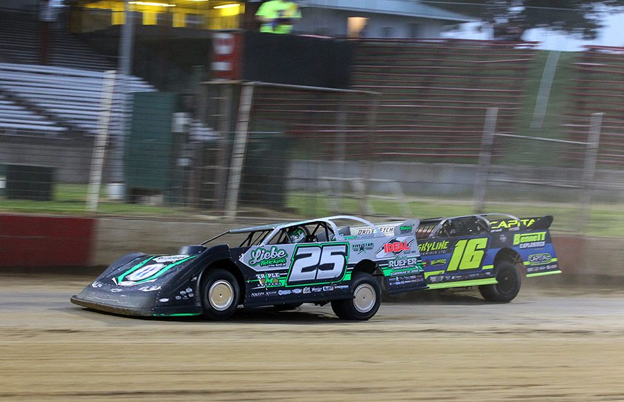 Chad Simpson (25) races ahead of Tyler Bruening during Saturday's Lucas Oil MLRA event at Dubuque Fairgrounds Speedway. (Mike Ruefer Photo)