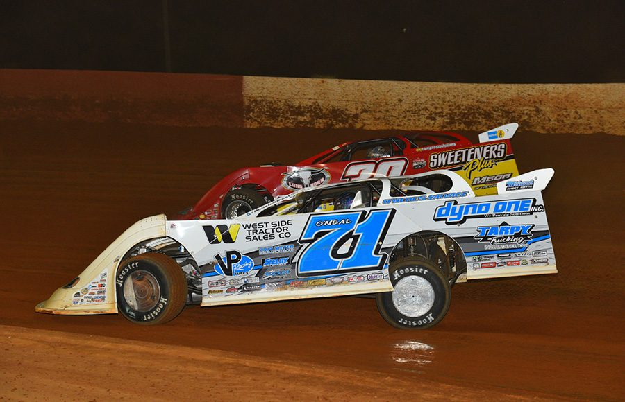 Hudson O'Neal (71) races under Tim McCreadie during Saturday's Lucas Oil Late Model Dirt Series feature at Smoky Mountain Speedway. (Michael Moats Photo)