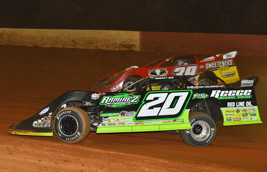 Jimmy Owens (20) races under Tim McCreadie during Saturday's Lucas Oil Late Model Dirt Series feature at Smoky Mountain Speedway. (Michael Moats Photo)