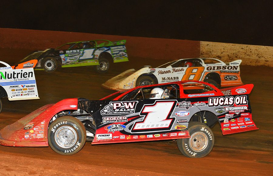 Earl Pearson Jr. (1), David Payne (8) and Tyler Erb battle for position during Saturday's Lucas Oil Late Model Dirt Series feature at Smoky Mountain Speedway. (Michael Moats Photo)