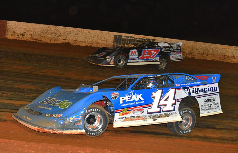 Josh Richards (14) races his Clint Bowyer Racing late model under Mike Marlar at Smoky Mountain Speedway. (Michael Moats Photo)
