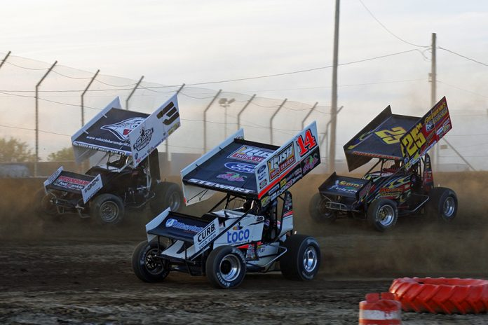 Tony Stewart (14), Jac Haudenschild (3) and Chris Andrews battle for position during Saturday's Ollie's Bargain Outlet All Star Circuit of Champions event at Attica Raceway Park. (Todd Ridgeway Photo)