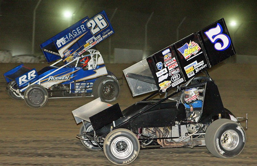 Cory Eliason (26) races ahead of Byron Reed during Saturday's Ollie's Bargain Outlet All Star Circuit of Champions event at Attica Raceway Park. (Todd Ridgeway Photo)
