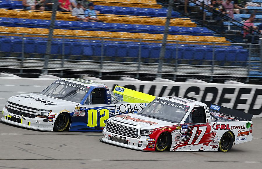 Raphael Lessard (17) battles Tyler Dippel during Sunday's NASCAR Gander Outdoors Truck Series event at Iowa Speedway. (Toyota Photo)