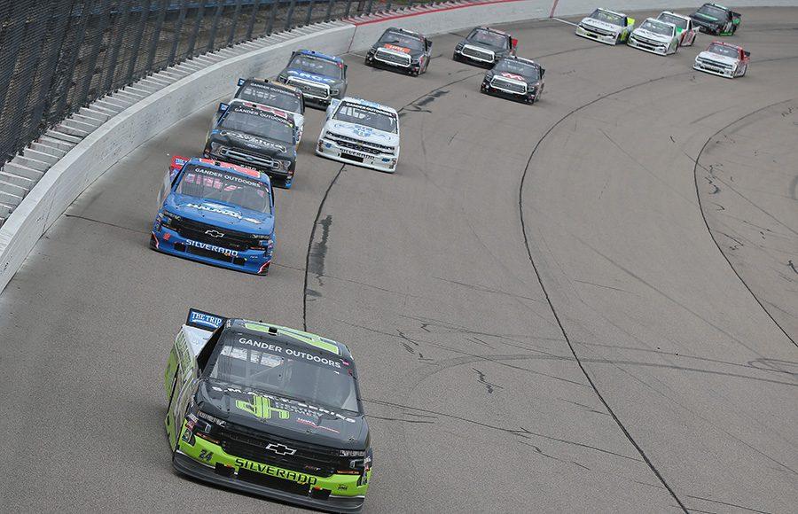 Brett Moffitt (24) leads a group of trucks during Sunday's NASCAR Gander Outdoors Truck Series event at Iowa Speedway. (NASCAR Photo)