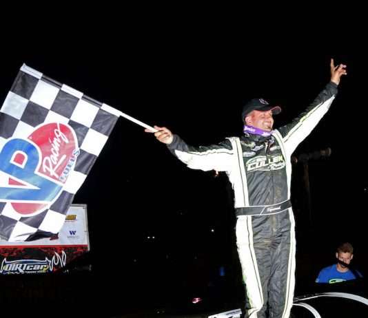 Brian Shirley celebrates winning Thursday's Summer Nationals feature at Spoon River Speedway. (Brendon Bauman photo)