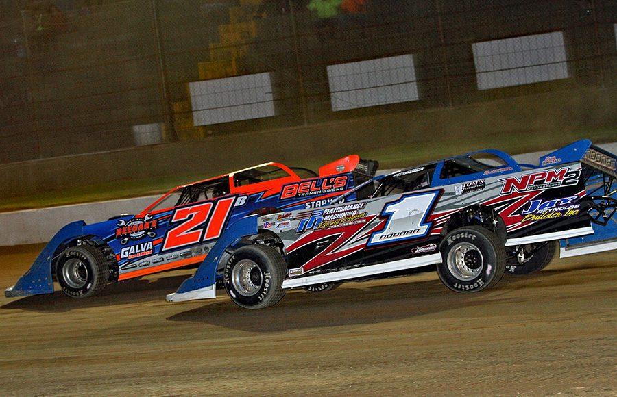 Casey Noonan (1) battles Rich Bell during Friday's American Ethanol Late Model Tour event at Hartford Speedway. (Jim Denhamer Photo)