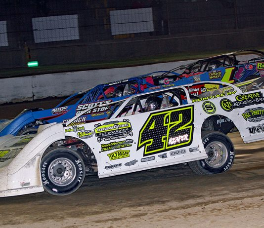 McKay Wenger (42), Travis Stemler (2) and Rusty Schlenk battle three-wide during Friday's American Ethanol Late Model Tour event at Hartford Speedway. (Jim Denhamer Photo)
