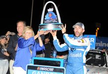 Ross Chastain celebrates in victory lane after his win Saturday at World Wide Technology Raceway. (Don Figler Photo)