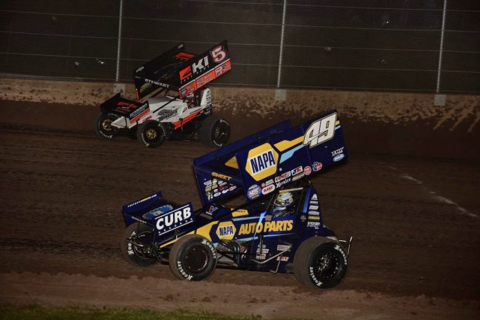 Brad Sweet (49) rolls under David Gravel Saturday night at Wisconsin's Beaver Dam Raceway. (Mark Funderburk photo)