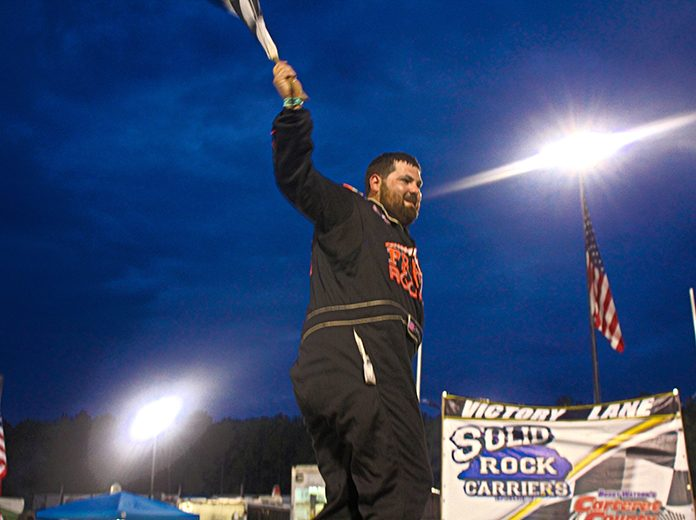 Brandon Clements celebrates in victory lane at Bobby Watson's Carteret County Speedway Saturday. (Andy Marquis Photo)