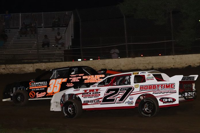 Toby Ott (27) made a low-side pass on Zach Zeugin (35) to claim the $1,500-to-win Street Stock Saturday at Central Missouri Speedway. (Joshua Allee Photo)