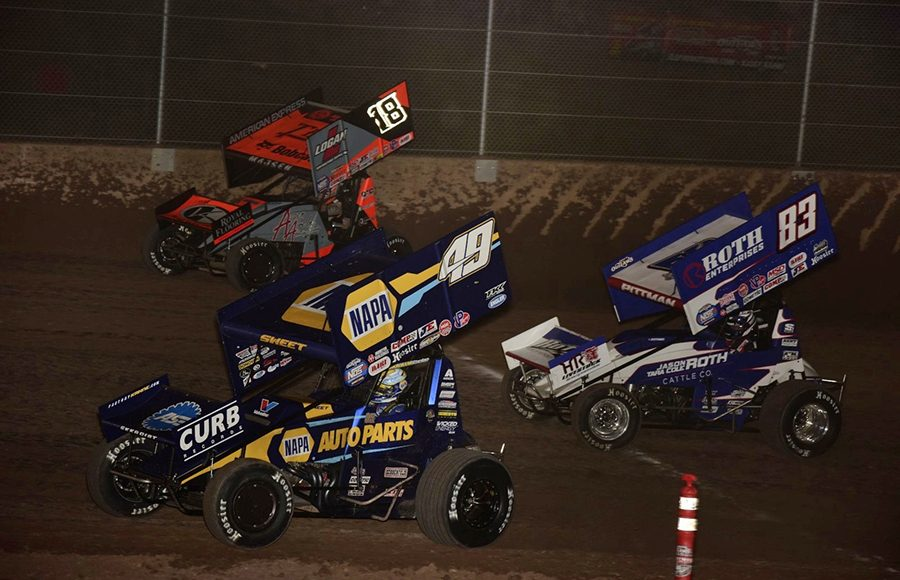 Brad Sweet (49), Ian Madsen (18) and Daryn Pittman battle for position during Saturday's World of Outlaws NOS Energy Drink Sprint Car Series feature at Beaver Dam Raceway. (Mark Funderburk Photo)