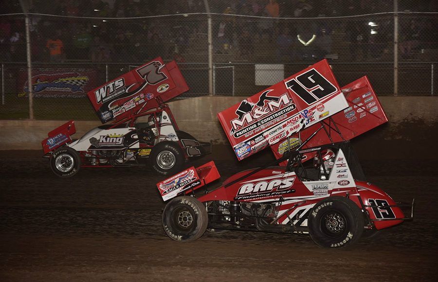 Jason Sides (7s) leads Brent Marks during Saturday's World of Outlaws NOS Energy Drink Sprint Car Series feature at Beaver Dam Raceway. (Mark Funderburk Photo)