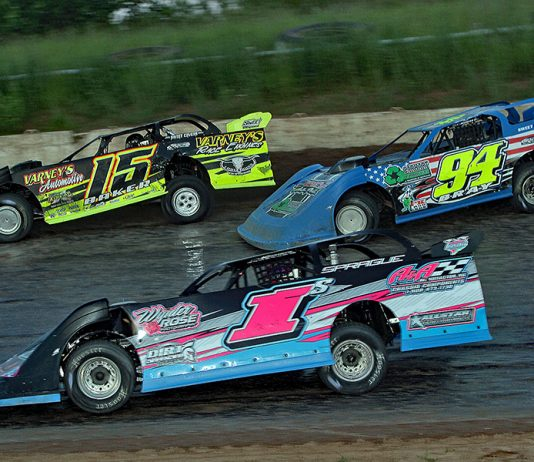 Andy Sprague (1), Bill Bray (94) and Dave Baker battle three-wide during Saturday's American Ethanol Late Model Tour event at Thunderbird Raceway. (Jim Denhamer Photo)