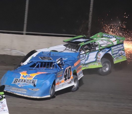 Kyle Bronson (40) slides under Tyler Erb, who bounces off the wall, Tuesday at Tri-City Speedway. (Brad Plant photo)