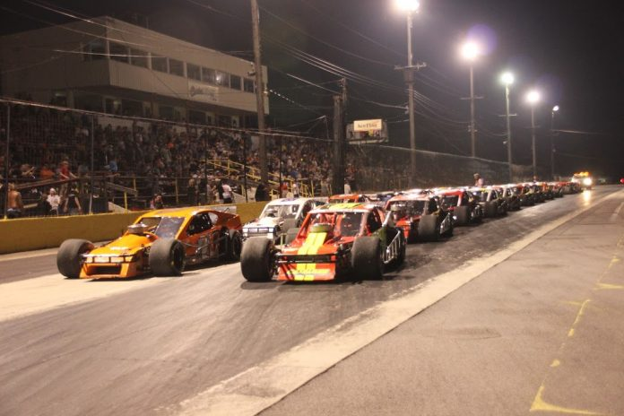 A large crowd watched the Race of Champions modifieds at Lancaster (N.Y.) Speedway Thursday night. (Paula Thompson photo)