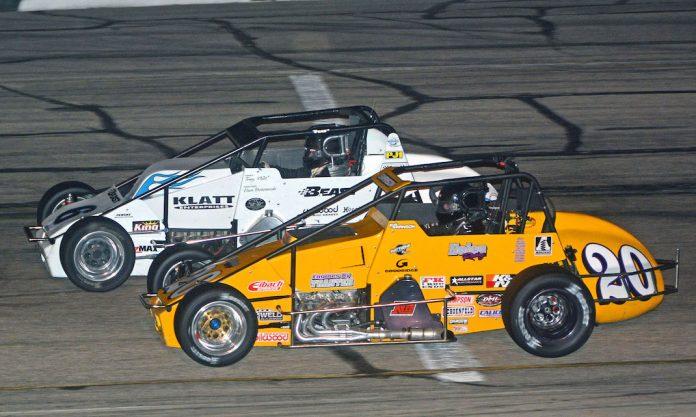 Kody Swanson (20) fights his way past Kyle Hamilton at Madison (Wis.) Int'l Speedway. (Stan Kalwasinski photo)