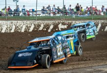Tony Anderson(22), Ryan Sutter(18) and Jerry Bowersock race hard in their modified heat race at Limaland. (Mike Campbell photo)