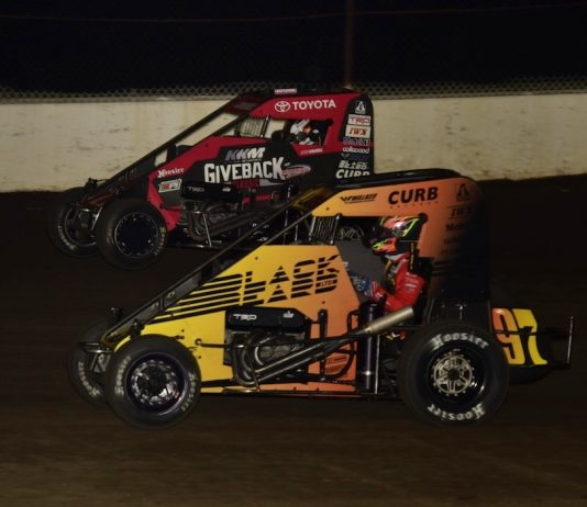 Kyle Larson (97) races under Jesse Colwell at the Dirt Oval at Route 66. (Mark Funderburk photo)