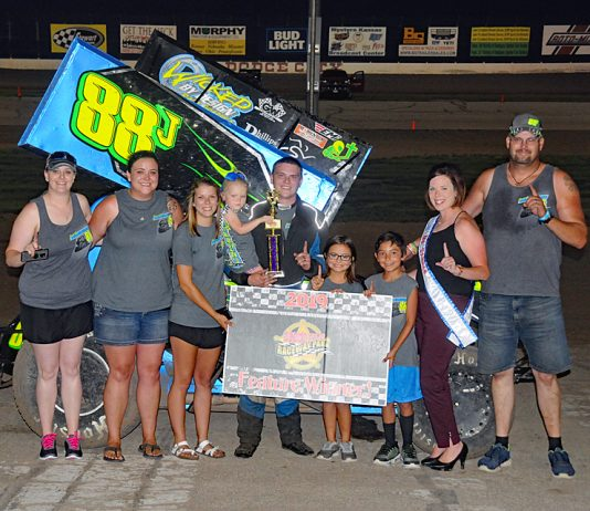 Dodge City Raceway Park sprint car winner Jeremy Huish in victory lane. (DCRP photo)