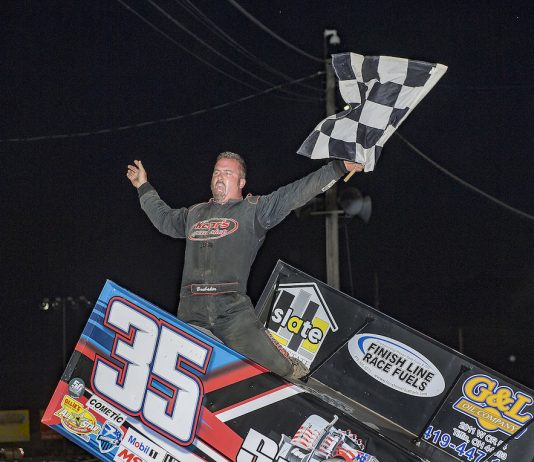 Stuart Brubaker celebrates winning Saturday's sprint car feature at Fremont Speedway. (Mike Campbell photo)