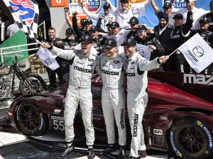 Harry Tincknell, Jonathan Bomarito and Olivier Pla celebrate in victory lane Sunday at Watkins Glen Int'l. (Dennis Bicksler Photo)