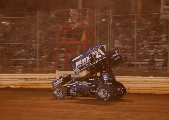 Brian Montieth takes the checkered flag Monday night at Lincoln Speedway. (Dan Demarco photo)