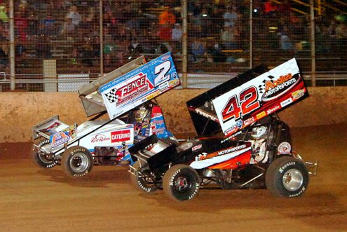 A.J. Flick (2) battles Sye Lynch at Lernerville Speedway. (Hein Brothers Photo)