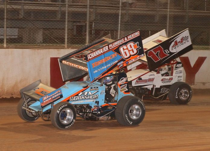 Lance Dewease (69k) races under Steve Buckwalter at Port Royal (Pa.) Speedway. (Dan Demarco photo)