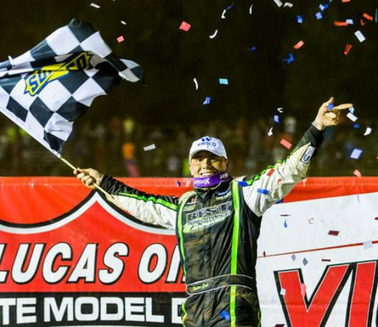 Tyler Erb celebrates his victory Friday night at Tyler County Speedway. (Heath Lawson Photo)
