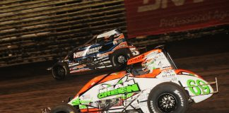 Brady Bacon (69) races under Chris Windom at Knoxville Raceway. (Julia Johnson photo)